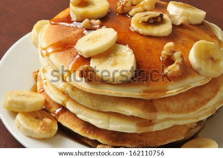 Closeup of a stack of banana nut pancakes - stock photo
