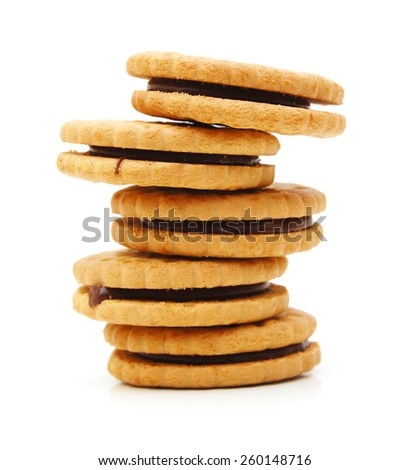 Closeup of a stack of filled cookies on white background - stock photo
