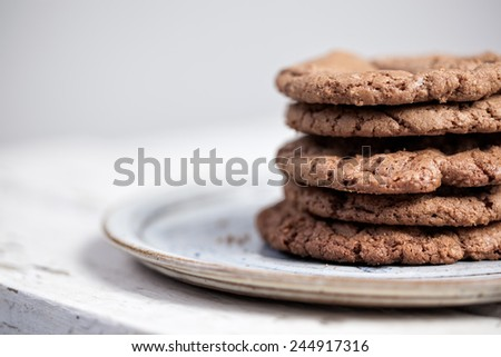 Closeup of a stack of homemade chocolate cookies on a plate with space for text - stock photo