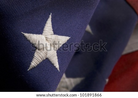 Closeup of a star stitched on an America Flag - stock photo