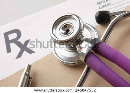Closeup of a stethoscope on a rx prescription - stock photo