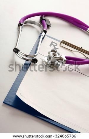 Closeup of a stethoscope on an rx prescription - stock photo