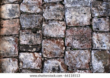 Closeup of a stone surface in an ancient Maya building in Chichen Itza, Mexico - stock photo