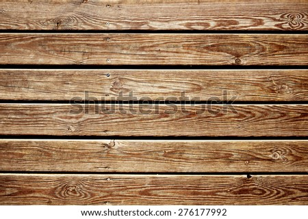closeup of a surface built of parallel rustic wood slats, to use as a background - stock photo