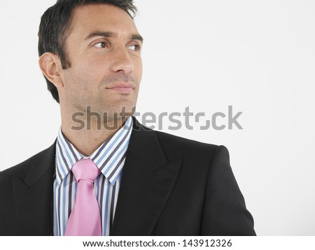 Closeup of a thoughtful businessman looking away against white background - stock photo