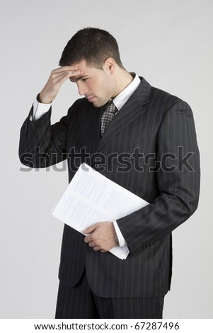 Closeup of a thoughtful smart business executive - stock photo