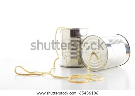 closeup of a tin cans phone isolated on white background, communication concept