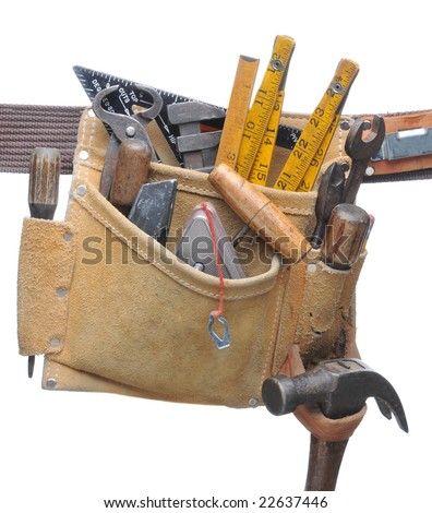 Closeup of a tool belt filled with assorted hand tools isolated over white - stock photo