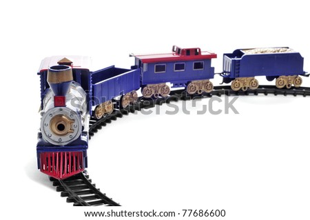 closeup of a toy train on a white background - stock photo