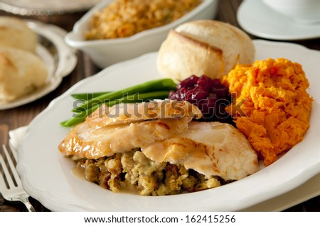 Closeup of a traditional Thanksgiving dinner. - stock photo