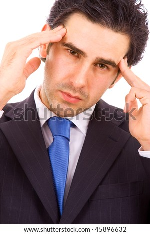 Closeup of a troubled young business man holding head in pain, isolated on white background - stock photo