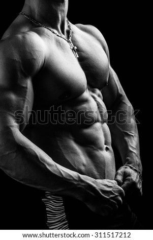 Closeup of a very strong hot sexy young guy bodybuilder. - stock photo