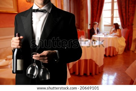 closeup of a waiter with bottle of wine and glass - stock photo