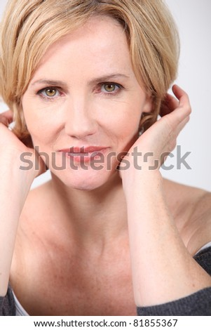 Closeup of a woman in her late thirties - stock photo