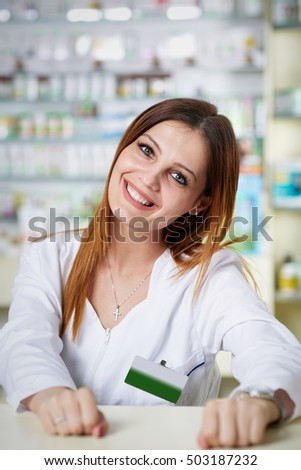 Closeup of a woman pharmacist over blurred background of medicine shelves