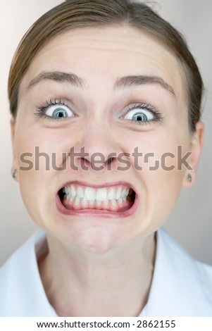 Closeup of a woman's face with uptight expression. - stock photo