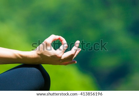 Closeup of a woman's hand meditating.  - stock photo