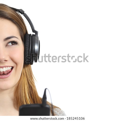 Closeup of a woman singing with headphones isolated on a white background - stock photo