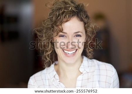 Closeup of a woman smiling at the camera