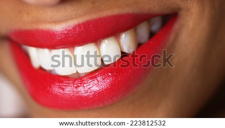 Closeup of a woman smiling with red lipstick