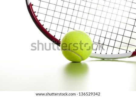 Closeup of a yellow tennis ball on white background - stock photo