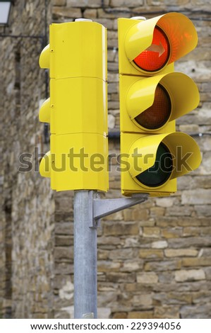 Closeup of a yellow traffic light. - stock photo