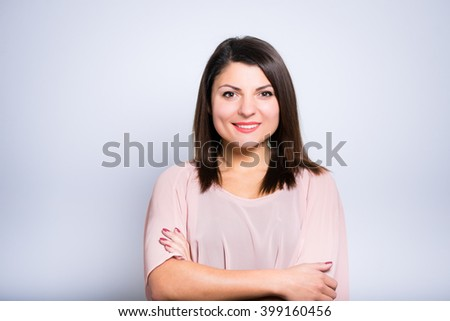 closeup of a young beautiful business woman crossed her arms - stock photo