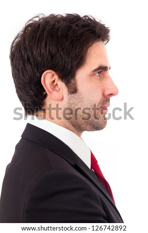 Closeup of a young business man from profile, isolated on white background