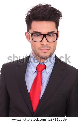 closeup of a young business man staring at the camera with a serious face, isolated on white