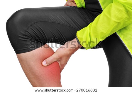 closeup of a young caucasian sportsman wearing sport clothes with his hand in his calf because of his calf muscle pain - stock photo