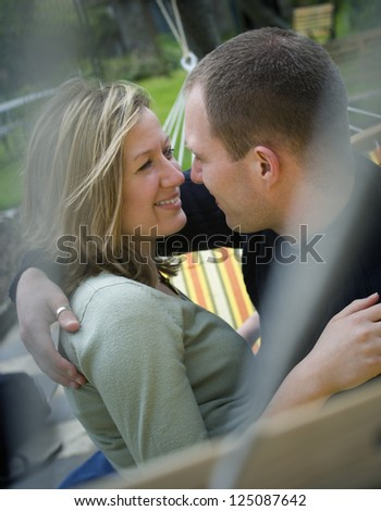 Closeup of a young couple embracing in a hammock - stock photo