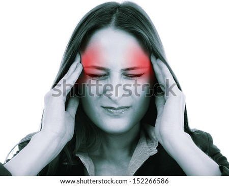 Closeup of a young unhappy woman with a severe headache holding forehead in pain - stock photo