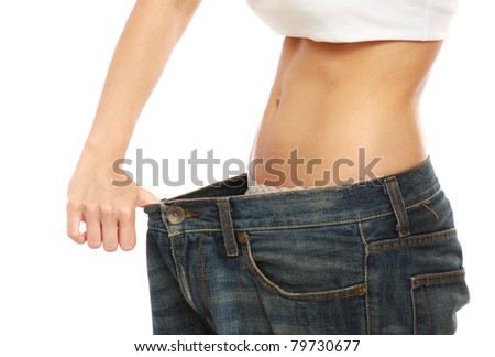 Closeup of a young woman showing how much she lost, isolated on white - stock photo