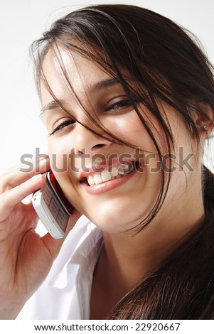 Closeup of a young woman talks and smile on cellphone. - stock photo