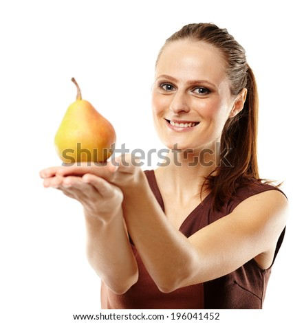 Closeup of a young woman with a pear isolated over white background