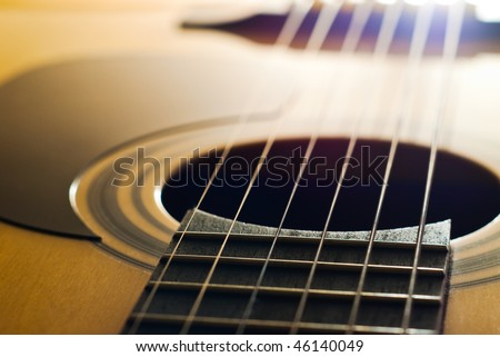 closeup of acoustic guitar with shallow depth of field - stock photo