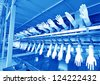 closeup of acrylonitrile butadiene gloves production line in a factory, north china - stock photo
