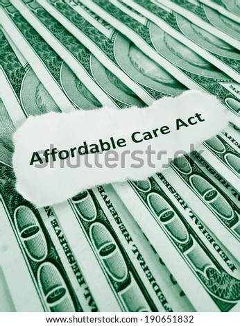 Closeup of Affordable Care Act, aka Obamacare text on money                                - stock photo