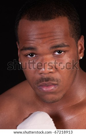 closeup of African American fighter over a black background - stock photo