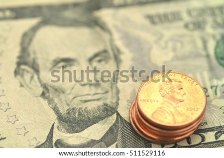 closeup of american banknotes and coins