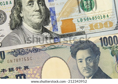 closeup of american dollar and yen- concept of currency exchange - stock photo