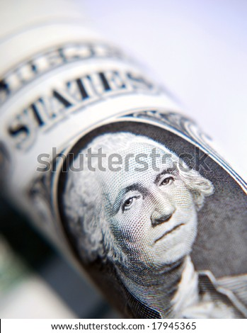 Closeup of American dollar notes focused on Washington