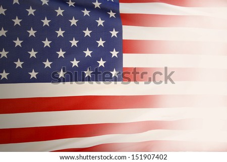 Closeup of American flag fading out. Copy space - stock photo