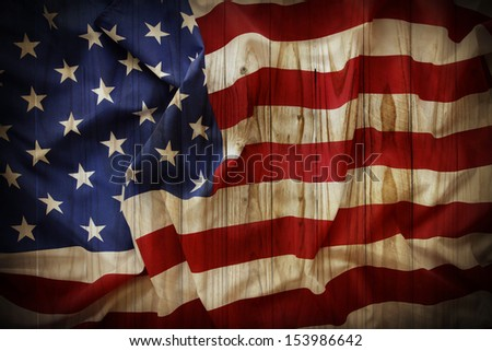 Closeup of American flag on fence background - stock photo
