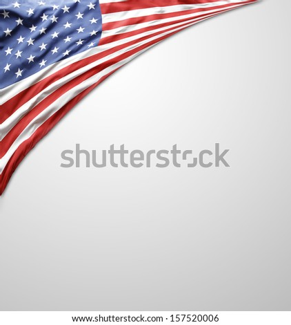 Closeup of American flag on plain background. Advertising copy space - stock photo