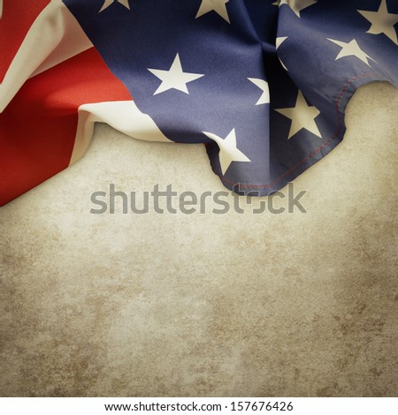 Closeup of American flag on textured background - stock photo