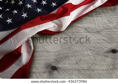 Closeup of American flag on wooden background - stock photo