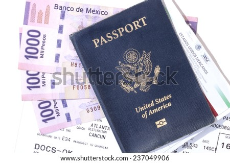 Closeup of American passport, pesos, boarding pass and tourist card for traveling to Mexico - stock photo