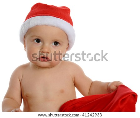 Closeup of an adorable baby boy in Santa's hat with big, questioning eyes.  Isolated on white. - stock photo