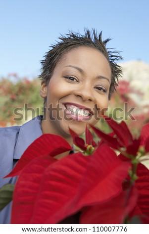 Closeup of an African American woman at garden center - stock photo